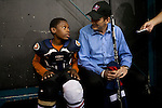 Republican presidential hopeful Tim Pawlenty talks with Kirjath Minick, 12, before playing in a scrimmage hockey game during a campaign stop on Friday, July 22, 2011 in Urbandale, IA.