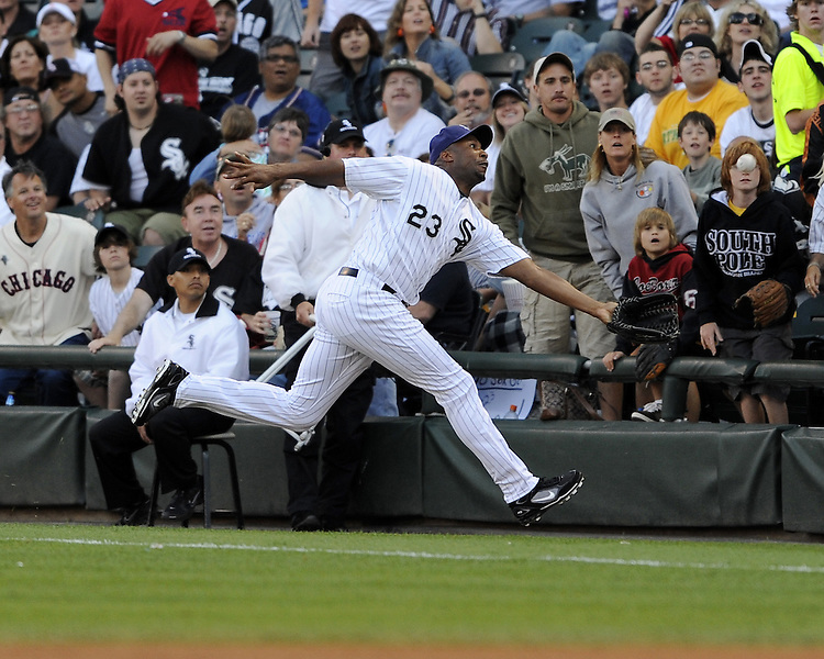 CHICAGO - JULY 5:  Jermaine Dye #24 of the Chicago White Sox makes a spectacular catch of a foul ball, landing into the seating area during the game against the Oakland A's at U.S. Cellular Field in Chicago, Illinois on July 5, 2008.  The White Sox defeated the A's 6-1.  (Photo by Ron Vesely)