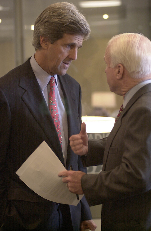Internet Privacy3(DG)072600 -- John F. Kerry, R-Mass., and John McCain, R-Ariz., talk outside the Senate Press gallery before the start of the internet privacy press conference.
