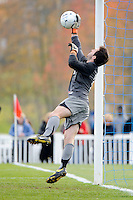 Dartmouth Big Green goalkeeper Lyman Missimer IV (25) makes a save off a free kick. Dartmouth defeated Monmouth 4-0 during the first round of the 2010 NCAA Division 1 Men's Soccer Championship on the Great Lawn of Monmouth University in West Long Branch, NJ, on November 18, 2010.