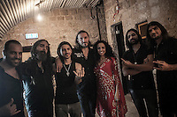 August 27, 2014 - Binyamina, Haifa District, Israel: From left to right: An invited musician (percussions) Uri (bass player), Cem (guitar player), Kobi Farhi (singer), Shlomit Levi (singer), Idan (guitar player) and Matan (drummer), musicians at Orphaned Land heavy metal band pose for picture in the backstage before to perform a concert in Binyamina Amphitheatre at north of Israel. Orphaned Land is a music band founded by Jewish and Arabian musicians who combine ethnic music with rock metal as they recite verses in Hebrew and Arabic from the sacred Quram and Tora Scriptures. (Narciso Contreras/Polaris)
