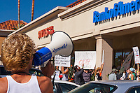 """Web"" (Andrew) leads a chant at a Bank of America in Irvine, CA during the Occupy Orange County, Irvine march on Saturday November 5."