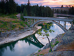 Idaho, North, Post Falls. The Spokane River below Post Falls dam flowing beneath the old WWP(Avista Utilities) access bridge.