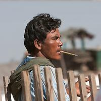 Myanmar, Burma.  Bagan.  Burmese Man with a Cheroot.