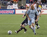New England Revolution midfielder Pat Phelan (28) and Colorado Rapids forward Conor Casey (9) contend for the ball.  The Colorado Rapids defeated the New England Revolution, 2-1, at Gillette Stadium on April 24.2010