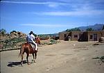 horseback rider at Taos pueblo