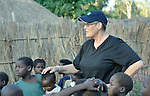 Sister Margaret Scott, a New Zealander and member of the Sisters of Our Lady of the Missions, visits with children in the Makpandu refugee camp in Southern Sudan, 44 km north of Yambio, where more that 4,000 people took refuge in late 2008 when the Lord's Resistance Army attacked their communities inside the Democratic Republic of the Congo. Attacks by the LRA inside Southern Sudan and in the neighboring DRC and Central African Republic have displaced tens of thousands of people, and many worry the attacks will increase as the government in Khartoum uses the LRA to destabilize Southern Sudan, where people are scheduled to vote on independence in January 2011. Catholic pastoral workers have accompanied the people of this camp from the beginning. Sister Margaret works in the area as a member of Solidarity with Southern Sudan, a pastoral presence of Catholic priests, sisters and brothers from around the world. NOTE: In July 2011 Southern Sudan became the independent country of South Sudan.
