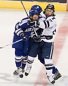 Scott Kozlak (Air Force - 8), Tony Thomas (Air Force - 20), Kevin Peel (Yale - 23) - The Yale University Bulldogs defeated the Air Force Academy Falcons 2-1 (OT) in their East Regional Semi-Final matchup on Friday, March 25, 2011, at Webster Bank Arena at Harbor Yard in Bridgeport, Connecticut.