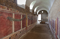 West wing of cryptoporticus, looking South, with frescoes with trompe l'oeil detailing of pillars and wreaths, in the Casa del Criptoportico, or House of the Cryptoporticus, Pompeii, Italy. The house is one of the largest in Pompeii and was owned by the Valerii Rufi family and built in the 3rd century BC. It takes its name from the underground corridor or cryptoporticus used as a wine cellar and lit by small windows. Pompeii is a Roman town which was destroyed and buried under 4-6 m of volcanic ash in the eruption of Mount Vesuvius in 79 AD. Buildings and artefacts were preserved in the ash and have been excavated and restored. Pompeii is listed as a UNESCO World Heritage Site. Picture by Manuel Cohen