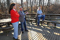 NWA Democrat-Gazette/FLIP PUTTHOFF<br /> Linda Brown (left) and Debbie Studyvin (cq) visit with Stanfill at the pavilion along the Eagle Watch Nature Trail at Swepco Lake. Bald eagles, turkey vultures and waterfowl are among the species to be seen and photographed from the pavilion.