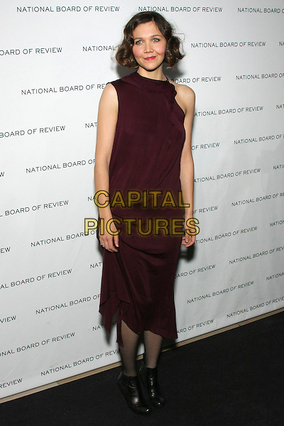 MAGGIE GYLLENHAAL .National Board of Review of Motion Picture Awards Gala held at Cipriani 42nd Street, New York, NY, USA, .12th January 2010. .full length purple aubergine maroon sleeveless dress black tights ankle boots .CAP/LNC/TOM.©LNC/Capital Pictures.