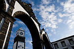 Clock tower of Sao Sebastiao church and old city gates in Ponta Delgada Azores