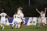 07 November 2008: Virginia teammates congratulate Lauren Alwine (holding number 2 Sarah Senty) following her first half goal. The University of Virginia and Virginia Tech played to a 1-1 tie after 2 overtimes at WakeMed Stadium at WakeMed Soccer Park in Cary, NC in a women's ACC tournament semifinal game.  Virginia Tech advanced to the final on penalty kicks, 2-1.