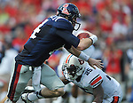 Mississippi quarterback Bo Wallace (14) is chased by Auburn linebacker Daren Bates (25) at Vaught-Hemingway Stadium in Oxford, Miss. on Saturday, October 13, 2012. (AP Photo/Oxford Eagle, Bruce Newman)..