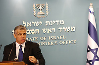 Israel's Finance Minister Yair Lapid during a press conference in his office, speaking about the reform in Israel's seaports, in Jerusalem, on July 3, 2013.  Photo by Oren Nahshon
