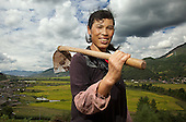 Hua (surname) Dexiang, 42, a woman belonging to the Naxi minority near her village in Yunnan province.