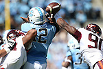 04 October 2014: UNC's Marquise Williams (12) is sacked by Virginia Tech's Ken Ekanem (left) as Dadi Nicolas (right) causes a fumble on the first play from scrimmage. The University of North Carolina Tar Heels hosted the Virginia Tech Hokies at Kenan Memorial Stadium in Chapel Hill, North Carolina in a 2014 NCAA Division I College Football game. Virginia Tech won the game 34-17.