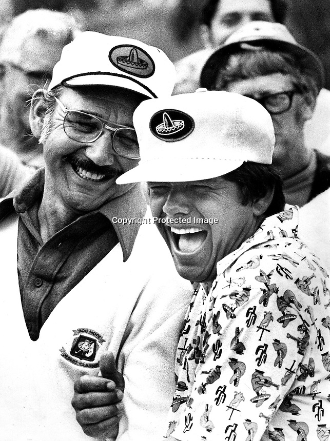 Golfer Lee Trevino shares a laugh with friend (1973<br />