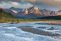 Scenic view of the Teklanika River and evening light on the Alaska range mountains in the distance, Denali National Park, interior, Alaska.