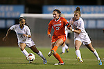 20 October 2013: Clemson's Katie Sprouse (29) is defended by North Carolina's Joanna Boyles (10) and Bianca Gray (4). he University of North Carolina Tar Heels hosted the University of Virginia Cavaliers at Fetzer Field in Chapel Hill, NC in a 2013 NCAA Division I Women's Soccer match. North Carolina won the game 2-0.