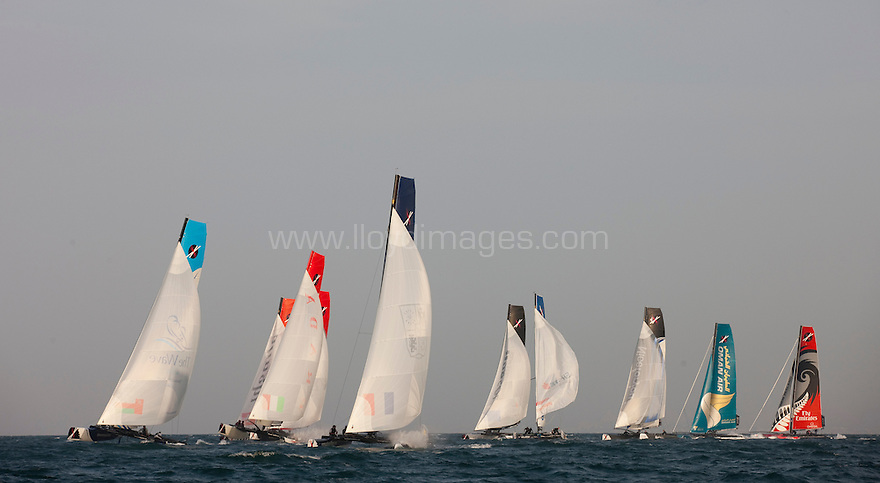Extreme Sailing Series 2011. Leg 1. Muscat. Oman.Day 2 of racing. The fleet race downwind..