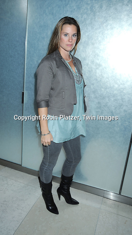"actress Ashley Williams posing for photographers at The Lifetime Television screening of Patricia Cornwell's novel ""The Front"" starring .Daniel Sunjata, Andie MacDowell and Ashley Williams at The Hearst Tower on April 7, 2010. The movie airs on April 10, 2010."