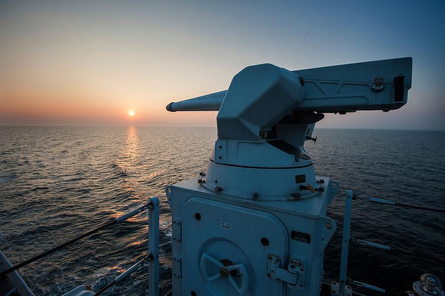 Nederland, Den Helder, 4 sept 2013<br /> Mitrailleur op patrouilleboot van de Marine de ZM Friesland.<br /> Marine moet ook fors bezuinigen.<br /> <br /> Foto(c): Michiel Wijnbergh