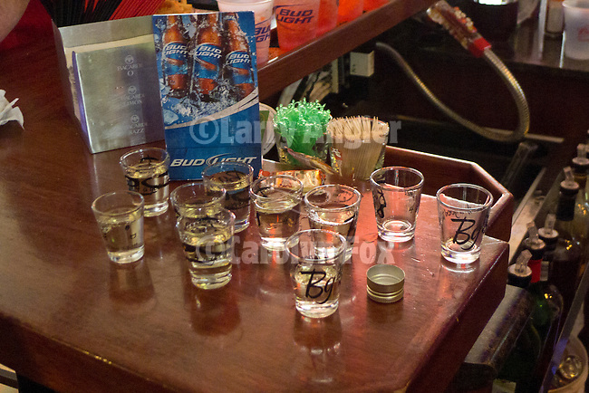 Shots of Serbian Slivowitz, plum brandy, are prepared for toasting in celebration of Christmas at BG's tavern.