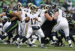 St. Louis Rams quarterback Case Keenum (17) looks to pass against the Seattle Seahawks at CenturyLink Field in Seattle, Washington on December 27, 2015.  The Rams beat the Seahawks 23-17.      ©2015. Jim Bryant Photo. All Rights Reserved
