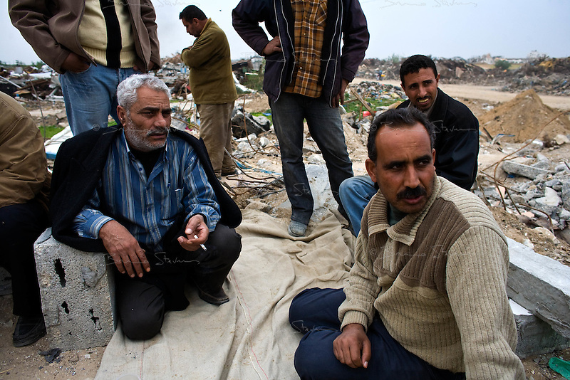Jabalya, Gaza Strip, Jan 23 2009..Taha Dalhul, left, is in shock; he has lost everything in the israeli attack..Stunned inhabitants of Jabalya return to where their homes, farms and factories used to stand, only to find a huge rubble field, levelled by Israeli bombs, explosives and bulldozers. Not a wall is standing over a very large area on the eastern side of the village facing the israeli border..