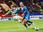 St Johnstone v Celtic..27.10.10  .Sam Parkin sends Glenn Loovens flying.Picture by Graeme Hart..Copyright Perthshire Picture Agency.Tel: 01738 623350  Mobile: 07990 594431