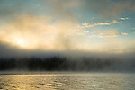 Idaho, West Central, New Meadows. Sunrise through morning steam on Lost Valley Reservoir.