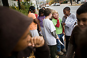 Rowan Nygard, 10, whispers with his fifth grade classmates at Central Park School For Children as they walk to the poll to cast their ballots in the Kids Voting Durham election on Tues., Nov. 4, 2008.