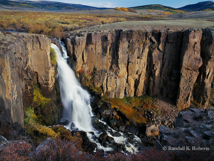 North Clear Creek Falls tumbles 100 feet over basalt rock on an autumn morning in Southwestern, Colorado, near Creede.