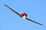 Questair Venture, flown by Mike Dacey, rounds the pylons during Super Sport Class racing at the 2009 National Championship Races in Reno, Nevada. Dacey finished 3rd in the Super Sport Gold race at a speed of 382 mph. The Venture is of all-metal construction using pre-formed multi-curvature panels and is supplied as a kit to homebuilders.