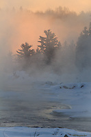 &quot;Sunrise over the St. Louis River&quot;<br /> <br /> Plumes of steam rise from the St. Louis River in the subzero (-16) temps. The rising sun paints the scene, adding a little warmth to an otherwise frigid morning.