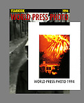 This a detail on the World Press Photo 1994 Yearbook title page, which shows my California firestorm photo of 1993, over the yearbook cover. While my photograph was the only one on the title page, neither that image nor a second firestorm photo inside he yearbook won an individual category award, but they were included in the thirty-nine country print exhibition tour of the World Press Photos.