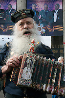 Moscow, Russia, 09/05/2011..A naval veteran sings and plays an accordion as Russian World War Two veterans and well-wishers gather in Gorky Park during the country's annual Victory Day celebrations.