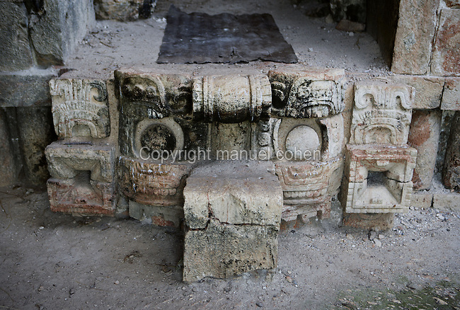"""Western façade of the Codz Poop (""""Rolled-up matting"""" in Maya), detail of a stair for the entrance shaped like a mask of Chaac, the big-nosed god of rain, Puuc Architecture, 700-900 AD, Kabah, Yucatan, Mexico. Picture by Manuel Cohen"""