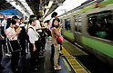 Tokyo, Japan - Japanese people form lines at Shinjuku Station. Morning commuters typically spend over one hour on the train going to work. Trains are usually so packed that train platform staff have to push commuters to fit in the train so that the doors can close shut. (Photo by Yumeto Yamazaki/AFLO)