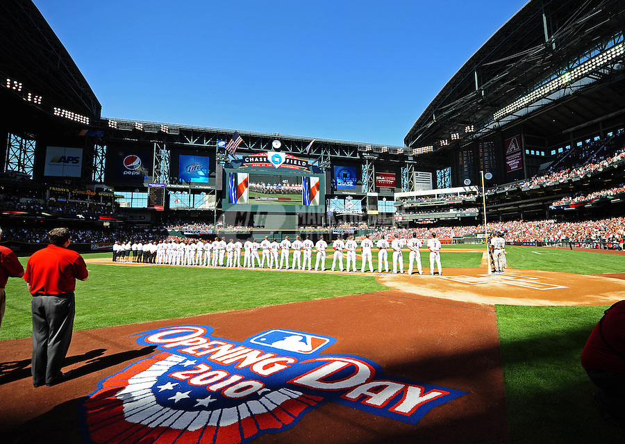Apr. 5, 2010; Phoenix, AZ, USA; Arizona Diamondbacks players line up for opening ceremonies prior to the game against the San Diego Padres during opening day at Chase Field. Mandatory Credit: Mark J. Rebilas-