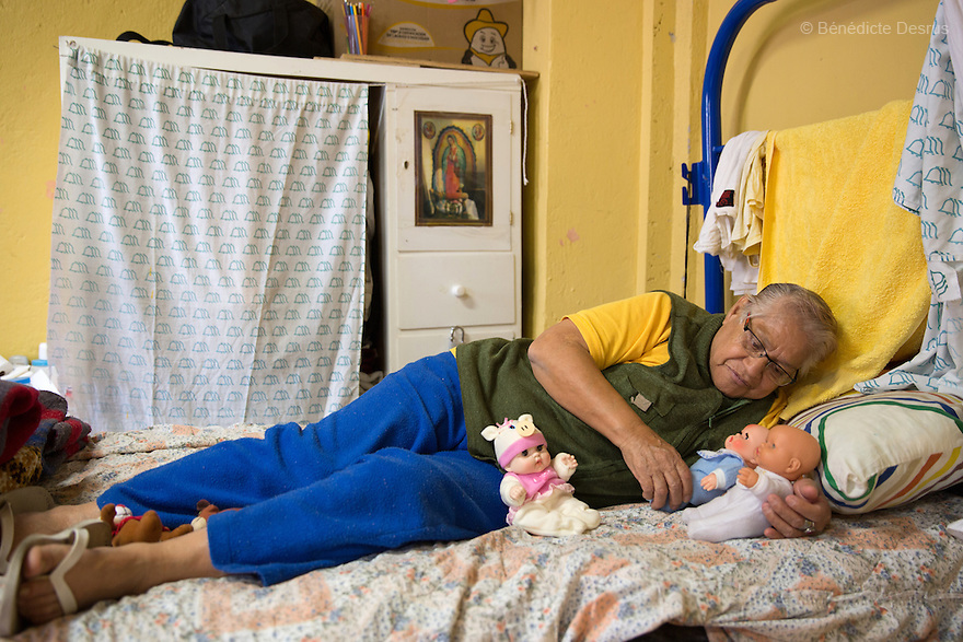 Elia, a resident of Casa Xochiquetzal, talks to her dolls as a method of coping with her past life, in her bedroom at the shelter in Mexico City, Mexico on February 6, 2017. Casa Xochiquetzal is a shelter for elderly sex workers in Mexico City. It gives the women refuge, food, health services, a space to learn about their human rights and courses to help them rediscover their self-confidence and deal with traumatic aspects of their lives. Casa Xochiquetzal provides a space to age with dignity for a group of vulnerable women who are often invisible to society at large. It is the only such shelter existing in Latin America. Photo by Bénédicte Desrus