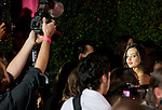 Photographers surround Victoria's Secret Angel Miranda Kerr before the start of 2011 Victoria's  Secret Fashion Show viewing party at the Samueli Theater at the Segerstrom Center of the Arts.