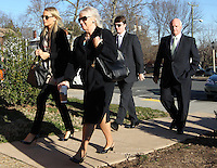 CHARLOTTESVILLE, VA - FEBRUARY 13: Yeardley Love's sister Lexie Love, left, is escorted with family members to the Charlottesville Circuit courthouse for the George Huguely trial. Huguely was charged in the May 2010 death of his girlfriend Yeardley Love. She was a member of the Virginia women's lacrosse team. Huguely pleaded not guilty to first-degree murder. (Credit Image: © Andrew Shurtleff