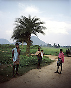 The protesting villagers, Daka Majhi (left), Prafulla Majhi (centre) with their cousin pose for a photo outside their house in Lanjigarh. Vedanta has been negotiating to buy some of his land but Daka has refused to sell his land to Vedanta. Six acres of his land (inside the refinery area) was forcibly bought from him in the past.