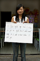 Xiang Xue - 18 Yrs.<br /> About to finish school after which she will migrate to Shanghai for a factory job.<br /> Hubei Province.<br /> <br /> 'I like english very much. I want to go on english but I don't much money. So I don't to know what I will go'.
