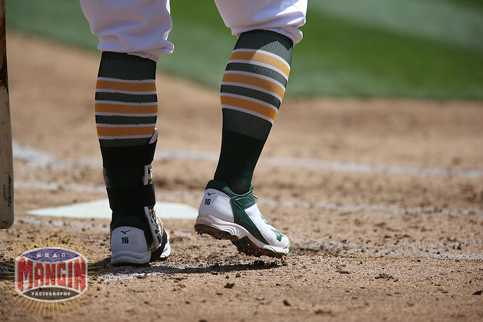 OAKLAND, CA - APRIL 9:  Detail of green and gold striped socks and white cleats belonging to Billy Butler #16 of the Oakland Athletics digging into the batters box against the Texas Rangers during the game at O.co Coliseum on Thursday, April 9, 2015 in Oakland, California. Photo by Brad Mangin
