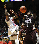Mississippi State's Renardo Sidney (1) blocks a shot by Mississippi's Jarvis Summers(32) at the C.M. &quot;Tad&quot; Smith Coliseum in Oxford, Miss. on Wednesday, January 18, 2012. (AP Photo/Oxford Eagle, Bruce Newman).