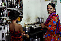 A mother and daughter in their home on 12th Dec 2006. Most homes measure 125 square feet with one room being used as kitchen, bedroom and sittingroom. People wash themselves in the alley ways outside their homes and there are lavatory blocks with approximately one lavatory per 100 residents.