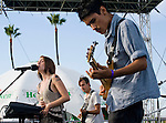 Enjuillet members Ela Kitapci, left, Taylor Morrow and Spencer Collins perform Saturday at the Balboa Beach Music Fest.